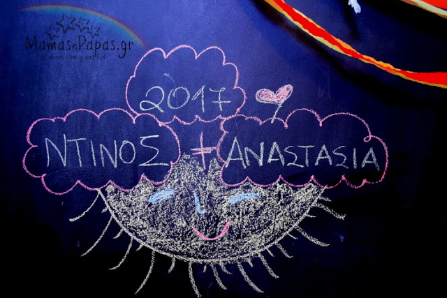 kids drawing on chalkboard